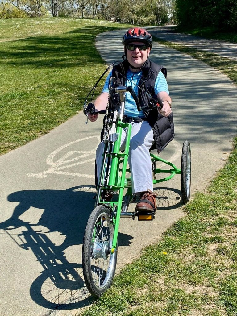 Darren on an adapted bike at Brooklands Park Worthing