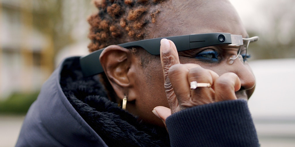 A woman wearing Envision glasses