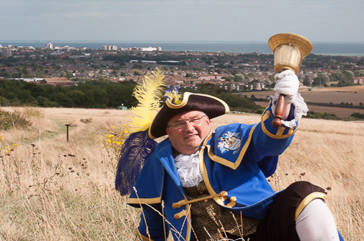 SSW President Bob Smytherman on Highdown Hill in his Town Crier attire