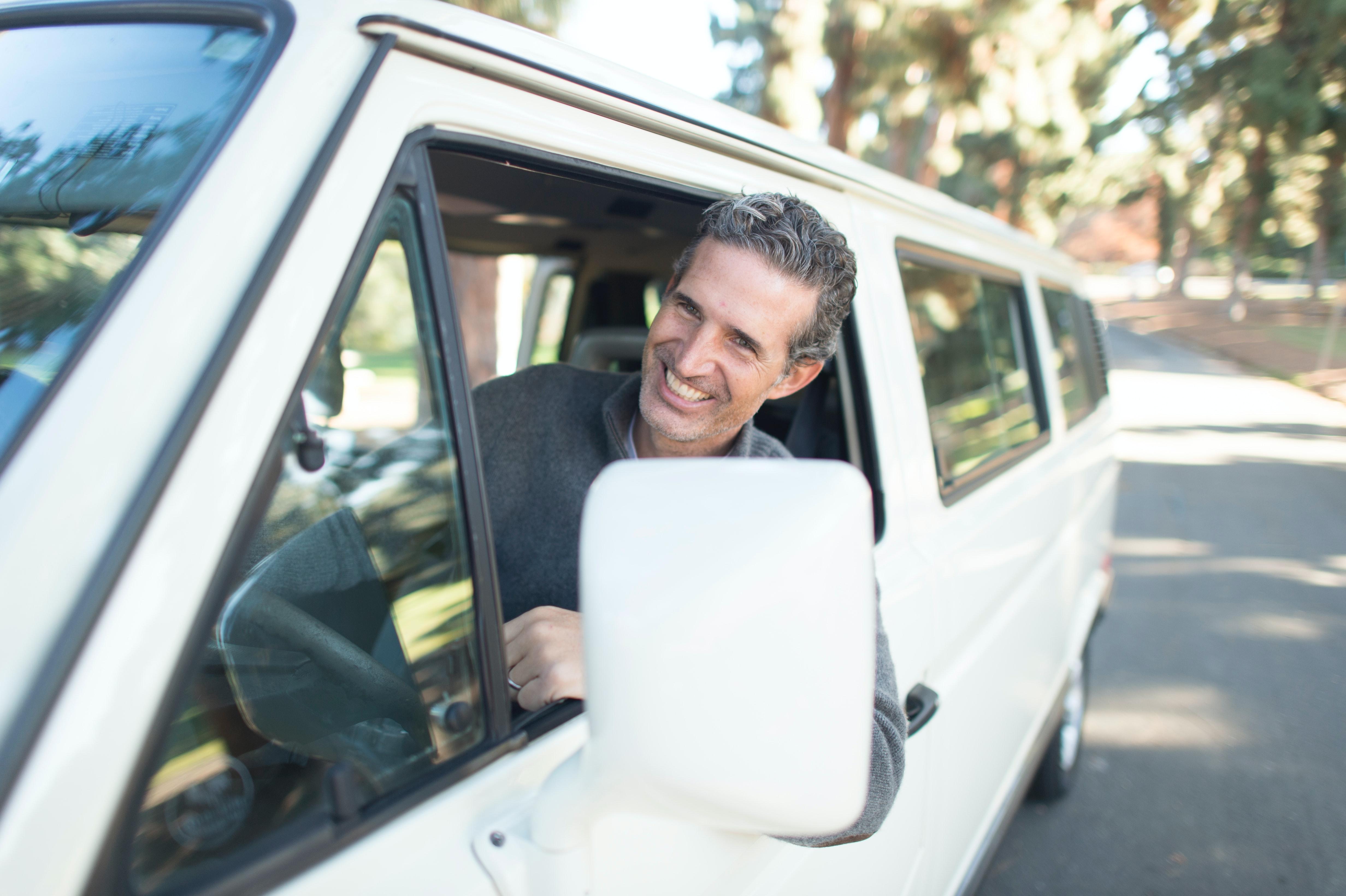 Happy man in minibus
