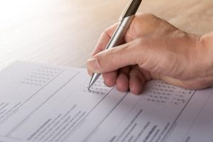 photo showing someone filling out form
