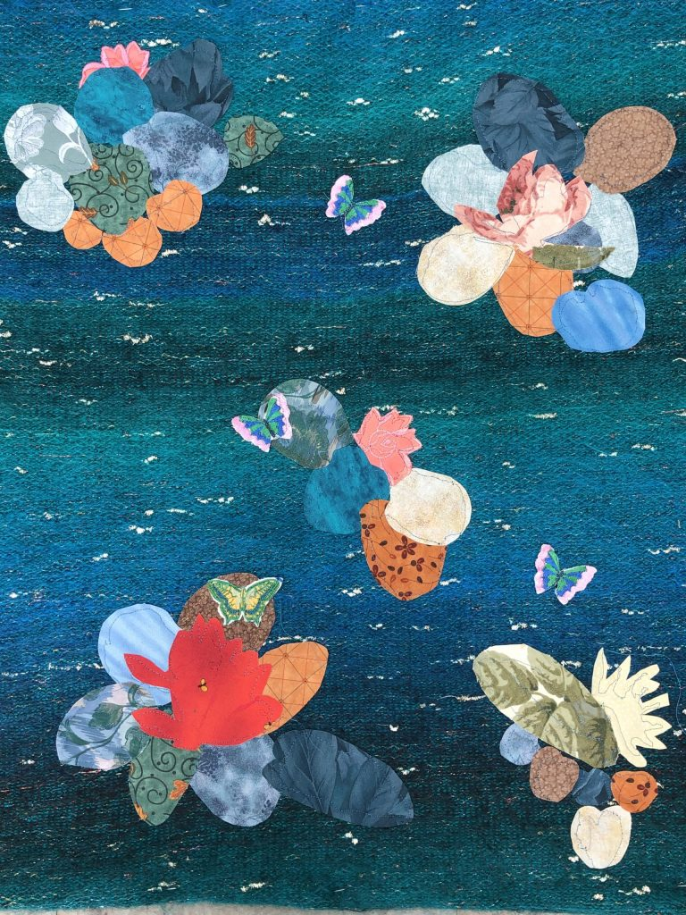 A fantastic mixed media picture of water lillies as created by someone in our Art Class